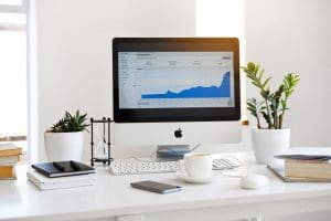 A photo of a computer showing a upward sloping graph | SEO for Mental Health Professionals can help counselors improve their search engine rankings | Simplified SEO Consulting