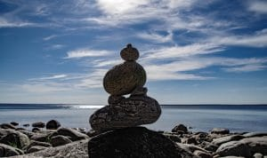 Balancing Rocks. Learn to balance getting to the top of Google and converting clients.