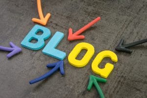 """Colorful letters spell out the word """"blog"""" with arrows pointing at it 