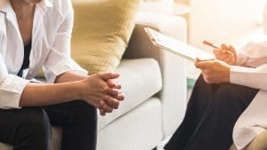 A therapist with a client in a full private practice | SEO tips and tricks | SEO Consulting Service