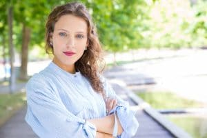 photo of young woman with curly hair in a blue shirt looking confident after receiving therapy | SEO example | Simplified SEO Consulting