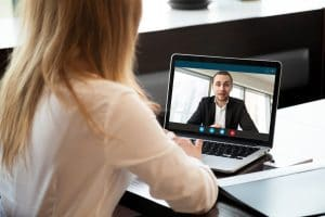 Photo of online therapist talking to client on a video call | SEO for online counseling pages | Simplified SEO Consulting