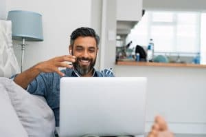 Happy client talking to therapist online | SEO for online counseling pages | Simplified SEO Consulting