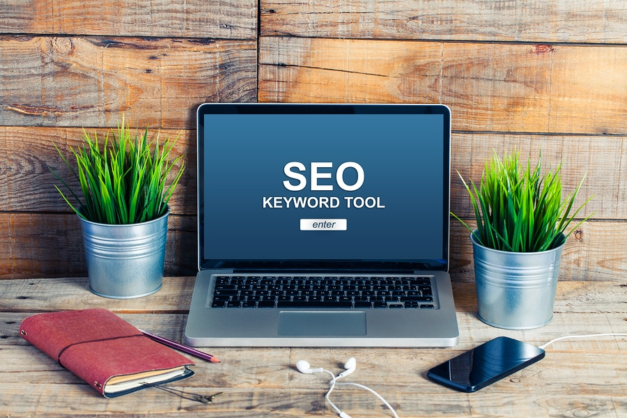 """Computer with the words """"SEO Keyword Tool."""" It's a peaceful looking workspace to represent how we make Search Engine Optimization less complicated for psychologists, psychiatrists, therapists and private practice owners."""