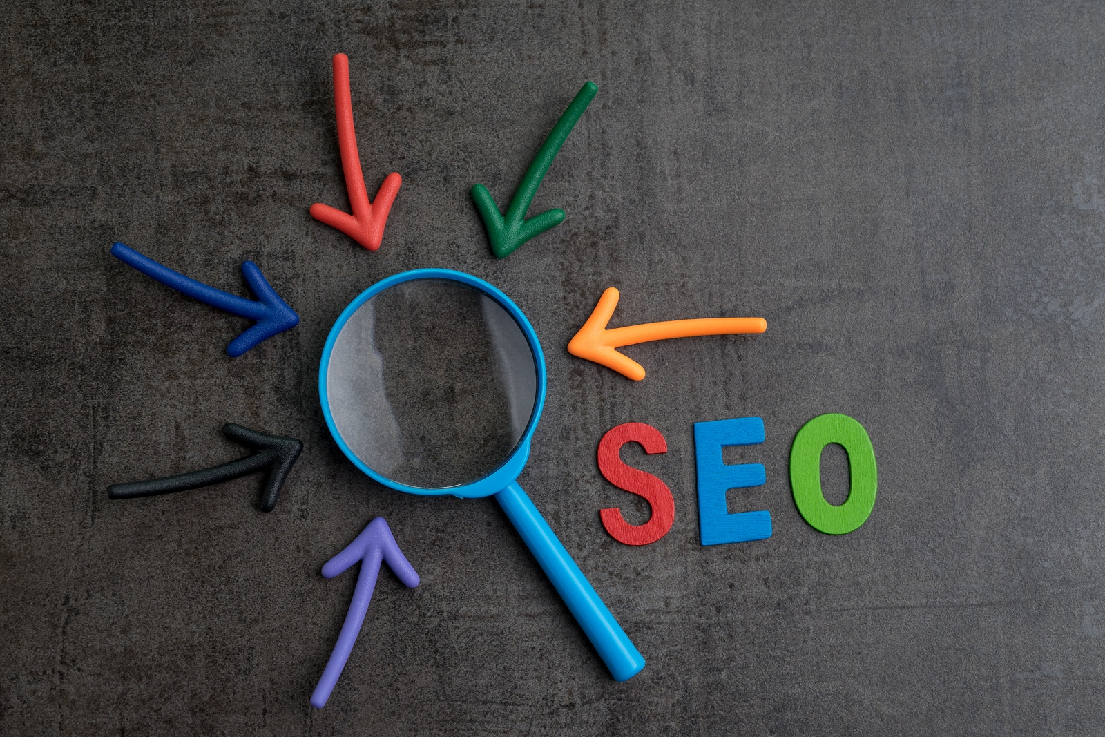 The letters S. E. O. with a magnifying glass and errors pointing to it to show how this post focuses on keyword placement for counseling websites to improve search engine optimization.