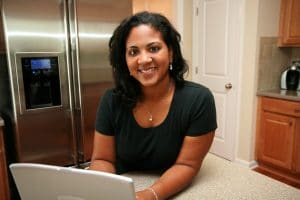hispanic woman working on her SEO from her home during COVID-19 outbreak. Begin SEO services with Simplified SEO Consulting now!