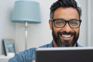 business man works on his SEO on his computer. He gets help from Simplified SEO Consulting
