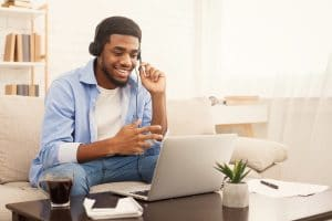 male therapist hold an online therapy session with his ideal client. He learned how to optimize his webpage with help from a member of the Simplified SEO Consulting Team who helped him rank better on google