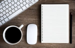 keyboard, coffee, mouse, and a notebook. Learn SEO tips for private practice owners from Simplified SEO consulting