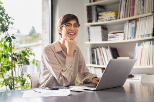 female therapist smiles at the camera after working on her private practice website's SEO and working with Simplified SEO consulting