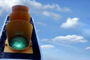 A lone traffic light stands on the left side of the image, with the green light seen glowing against the sunny sky. Image for Simplified SEO Consulting can help on your SEO journey. Contact us today!