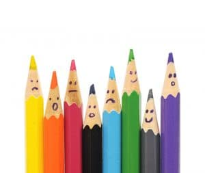 Colored pencils are shown with faces drawn on them. This concept is related to boosting SEO.