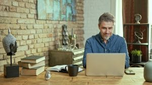 man working on the seo for his private practice website after SEO training with simplified SEO consuting
