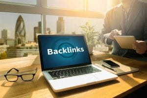 """Photo of a computer with the word """"backlinks"""" on the screen sitting on a table representing how therapist directories can help psychotherapists build backlinks and therefore build SEO."""