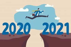 Photo of a person jumping from 2020 to 2021 representing how Simplified SEO Consulting is looking at how to change our SEO strategy as we head into the new year following Google's December 2020 core algorithm update