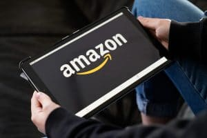 Photo of Amazon's logo on a tablet representing how some sources say December 2020's Google Algorithm update may have had a negative impact on big businesses.