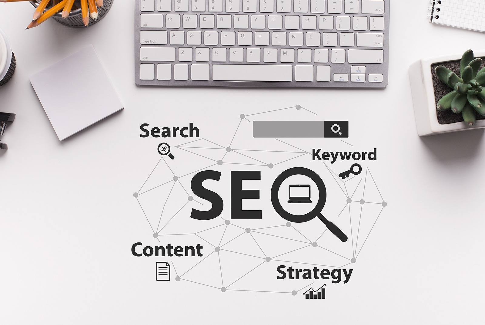 Top down perspective of SEO graphic next to a keyboard. Understanding SEO can be a hard task, but we can help. Simplified SEO Consulting offers seo help for therapists.