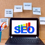 computer with the text SEO with seo keywords around it. Learn about optimizing your website from an seo specialist