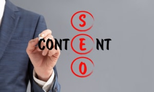 photo of a person writing the SEO and content representing the importance of having good readability when optimizing your website. Learn more about SEO for therapists