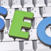 """The letters """"SEO"""" on top of a keyboard. This could symbolize the prevalence and importance of SEO consulting services. Simplified SEO consulting offers optimization options."""