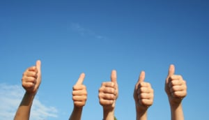 "Image of five hands holding a ""thumbs up"" against a blue sky background. This image represents the good SEO for psychiatrists that happens when they work on getting backlinks."