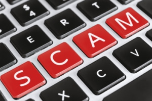"""The word """"scam"""" is spelled out on a keyboard for Simplified SEO Consulting. We offer support for"""