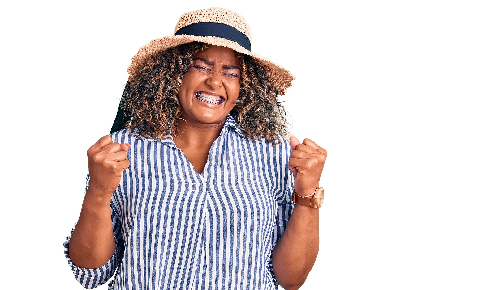 Woman wearing a striped shirt and hat, holding her hands together excited to start SEO services for her private practice therapy business with SEO experts from Simplified SEO Consulting in the United States, UK, Canada, Mexico, Germany, Spain and beyond.