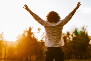 Image of a man holding his arms up in celebration. Therapists with a private practice website can celebrate after working with a SEO consulting service company.