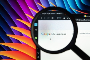 Magnifying glass zooming in on Google my business. If you're looking for SEO help for therapist, you have come to the right place. Our SEO specialists can give you insightful tips for GMB optimization. Learn more about Google my business in counseling, social work, psychology, and more!