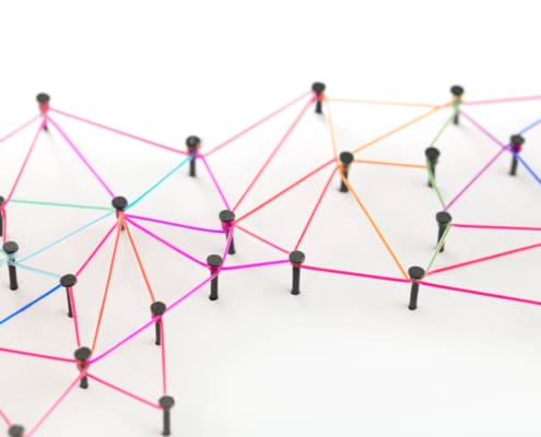 yarn linking pins together like a web- Simplified SEO consulting- backlinks- spammy backlinks- porn site back link