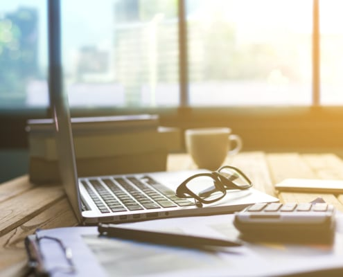 A set of glasses rest on a laptop as the morning sunlight pours through the window. This could represent SEO marketing for therapists. Contact Simplified SEO Consulting for SEO training. We support therapist SEO efforts and other services.