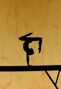 a gymnast on a balance beam with feet in the air. Tokyo 2020 Olympics have been far from normal. Through Simone Biles' choice to put her mental health first, private practice therapists can work on their SEO and reach their ideal clients. Reach out to an SEO Specialist today! 65202 | 65203 | 65201