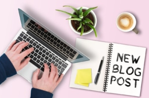 A laptop, plant, coffee, and notebook saying New Blog Post. Blogging is important for SEO. Reach out to an SEO specialist today to help with SEO for therapists.